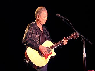 Fingerstyle guitar - Guitarist Lindsey Buckingham playing an amplified acoustic guitar using fingerpicking technique
