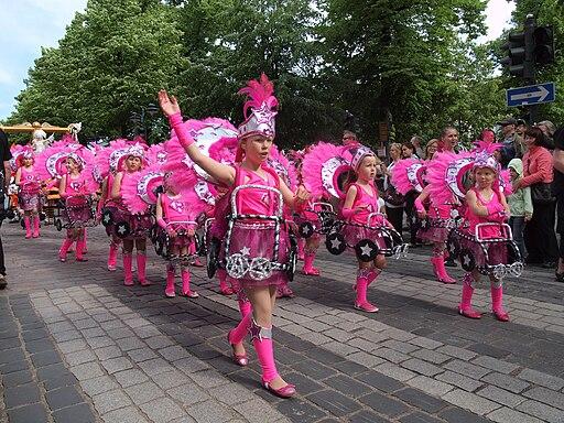 Little samba girls in pink costumes from União da Roseira at the Helsinki Samba Carnaval 2014