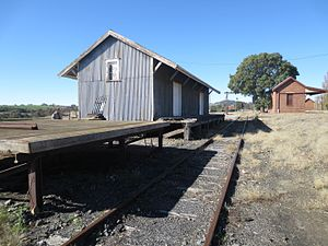Siding (rail) - Derelict industrial rail siding showing old platform and warehouse at the disused Galong railway station, Australia (circa 2016)