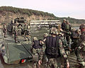 M2 Bradleys debarks a pontoon bridge.jpg