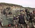 M2 Bradleys debarks a pontoon bridge.jpg