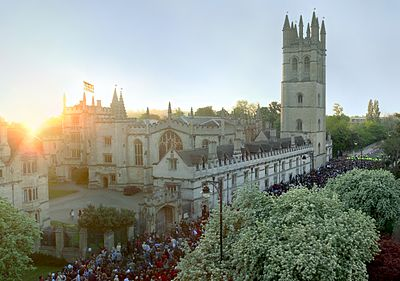 Magdalen College on May Morning. By tradition, revellers gather outside the college at 6am on 1 May (many having attended all-night balls and parties) and the college choir sings madrigals from the top of Magdalen Tower.