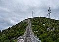 Maintenance crew working on a power pylon next to the city walls, Ston, Croatia (PPL1-Corrected) julesvernex2.jpg