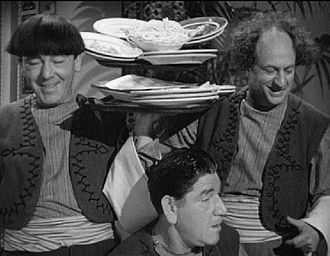 Larry Fine - Larry Fine (right) in 1949's Malice in the Palace with Moe Howard and Shemp Howard.
