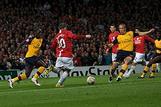2009 UEFA Champions League Final - Wayne Rooney and Mikaël Silvestre compete for the ball during the semi-final first leg between Manchester United and Arsenal.