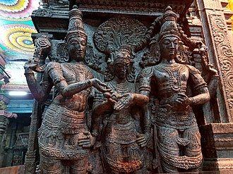 Meenakshi Temple - Vishnu (left) gives away his sister and bride Meenakshi's hand into the waiting hand of groom Shiva. The temple commemorates this legend every year with a festive procession.