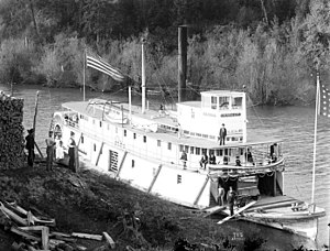 """Steamboats of the Columbia River - Mascot, a typical Columbia river steamer, """"wooding up,"""" circa 1900."""