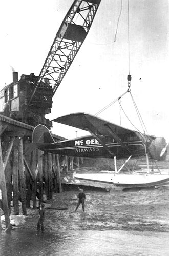 Ship Creek, Alaska - A McGee Airways plane being lowered into Ship Creek.