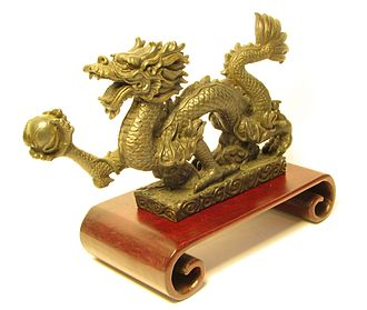 Chinese dragon - Chinese metal dragon half frontal view, holding a pearl in his paw. It is a taboo to disfigure a depiction of a dragon.