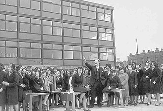 Michael Duane - Headmaster Michael Duane welcomes pupils to the new Risinghill School, 4 March 1960.