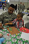 Military members, families enjoy Holiday party 161202-F-WF462-053.jpg