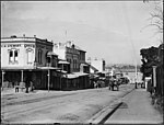 Milson's Point street scene with horses and carts (3054172419).jpg