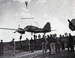 Mitsubishi Ki-46 is loaded on USS Attu (CVE-102) 1944.jpg
