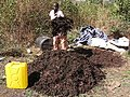 Mixing the compost heap manually, water is being added for right moisture content (video) (6882161971).jpg