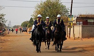 Bekkersdal - Mounted police in Bekkersdal, ahead of the 2014 election