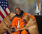NASA astronaut Leland D. Melvin with his dogs Jake and Scout.jpg