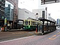 Nagasaki Electric Tramway 502&377 at Tsukimachi Station.jpg