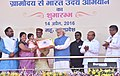 """Narendra Modi presenting the credit certificates, under various schemes to the beneficiaries from Scheduled Casts, at the launching ceremony of the """"Gram Uday se Bharat Uday"""" Abhiyan, in Mhow, Madhya Pradesh (8).jpg"""