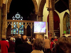 O Come, All Ye Faithful - A congregation in England sings the song during Christmas 2006