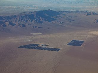 Solar power in the United States - Nevada Solar One, with the Las Vegas Valley beyond the mountains behind it.