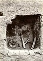 Niche in wall of the rooms, showing some household articles, headcarriers, etc. as found when opened. (d84c161f5df446e98bf58c0d7acfeb23).jpg