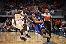 Duke Blue Devils guard Nolan Smith (2) drive past Miami Hurricanes guard Durand Scott (1) during the game between Miami and Duke at Bank United Center in Coral Gables, Florida.
