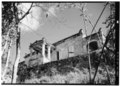 OBLIQUE VIEW OF WEST ELEVATION, SHOWING PORCH AND RETAINING WALL - Estate Reef Bay, Great House, Reef Bay, St. John, VI HABS VI,2-REBA,1-A-2.tif