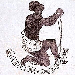 "Drawing which shows a slave kneeling and holding up his clasped and manacled hands. Underneath him, a banner says ""Am I Not a Man and a Brother?"""