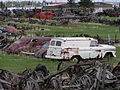Old rusty cars and agricultural equipment (2553217955).jpg