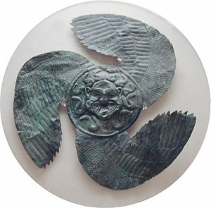 Gorgoneion - Winged Gorgoneion from Olympia, originally an apotropaic shield decoration, early sixth century BC