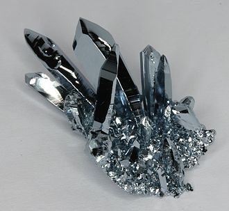 Osmium - Osmium crystals, grown by chemical vapor transport.