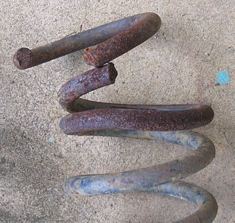 Coil spring - Oxy-cut spring showing deformation due to loss of tempering in adjacent turn