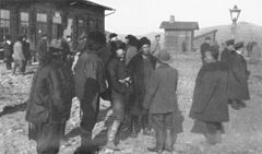 P380 Chinese gold-miners at Transbaikal railway station Mogocha.jpg