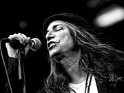 Patti Smith singing into a Shure SM58 microphone