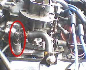 Crankcase ventilation system - PCV valve on Ford Taunus V4 engine in a Saab 96, between left valve cover and intermediate flange on intake manifold