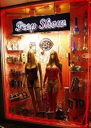 Pornographic entertainment advertised in a sex shop window