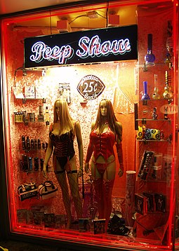 Pornographic entertainment on display in a sex shop window, where there is usually a minimum age to go into pornographic stores Peep Show by David Shankbone.jpg