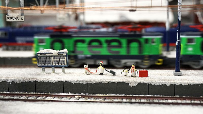 File:Penguins waiting in a train station.jpg