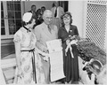 Photograph of President Truman outside the White House receiving a certificate from representatives of Girls Nation... - NARA - 200226.tif