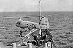 Piasecki HUP-2 Retriever hovers over USS Boston (CAG-1), circa in 1959.jpg