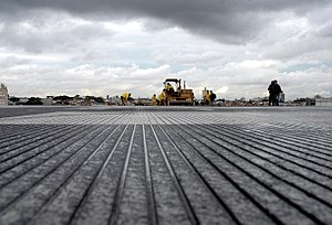 São Paulo–Congonhas Airport - Workers adding grooves to the main runway at Congonhas Airport in 2007