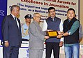 Pranab Mukherjee presented the National Awards for excellence in journalism, at the National Press Day celebrations, in New Delhi. The Minister of State for Information & Broadcasting, Col. Rajyavardhan Singh Rathore (3).jpg