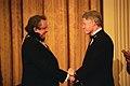 President Bill Clinton shakes hands with Johnny Cash.jpg