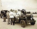 President Franklin Roosevelt rides in a Jeep in Natal, Brazil (24764377949).jpg