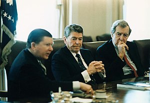John Tower - Tower delivers the Tower Report to President Reagan in the White House Cabinet Room, Edmund Muskie at right, 1987.