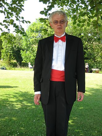 Cummerbund - A red cummerbund with matching bowtie worn by a professor