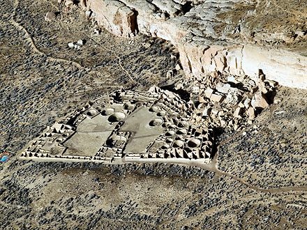 Pueblo Bonito, the largest of the Chacoan Great Houses, stands at the foot of Chaco Canyon's northern rim. Pueblo Bonito Aerial.JPG