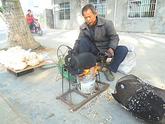 "Puffed grain - Puffed grain machine in Haikou, Hainan, China. Sometimes called a ""popcorn hammer"""