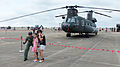 ROCA Sergeant 1st class and Visitors Photographing in Front of CH-47 20140719.jpg