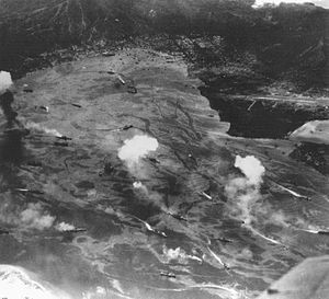 Bombing of Rabaul (November 1943) - Japanese warships attempt to get under way while being attacked by US Navy aircraft.